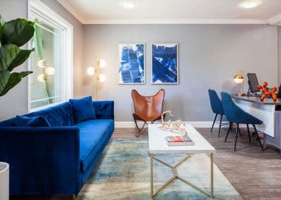 living room with blue sofa and blue chair