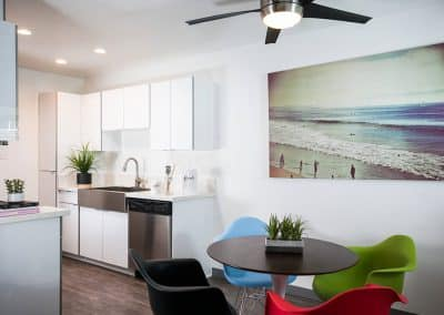 Uptown Fullerton living roomy along with kitchen area