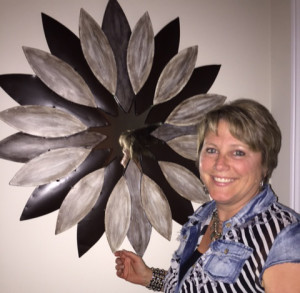 Kelly Myers with her artwork