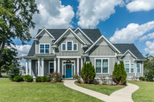 maryland mortgage refinance rates seen in blue house with big clouds behind it.