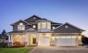 A brightly lit home with a large garage