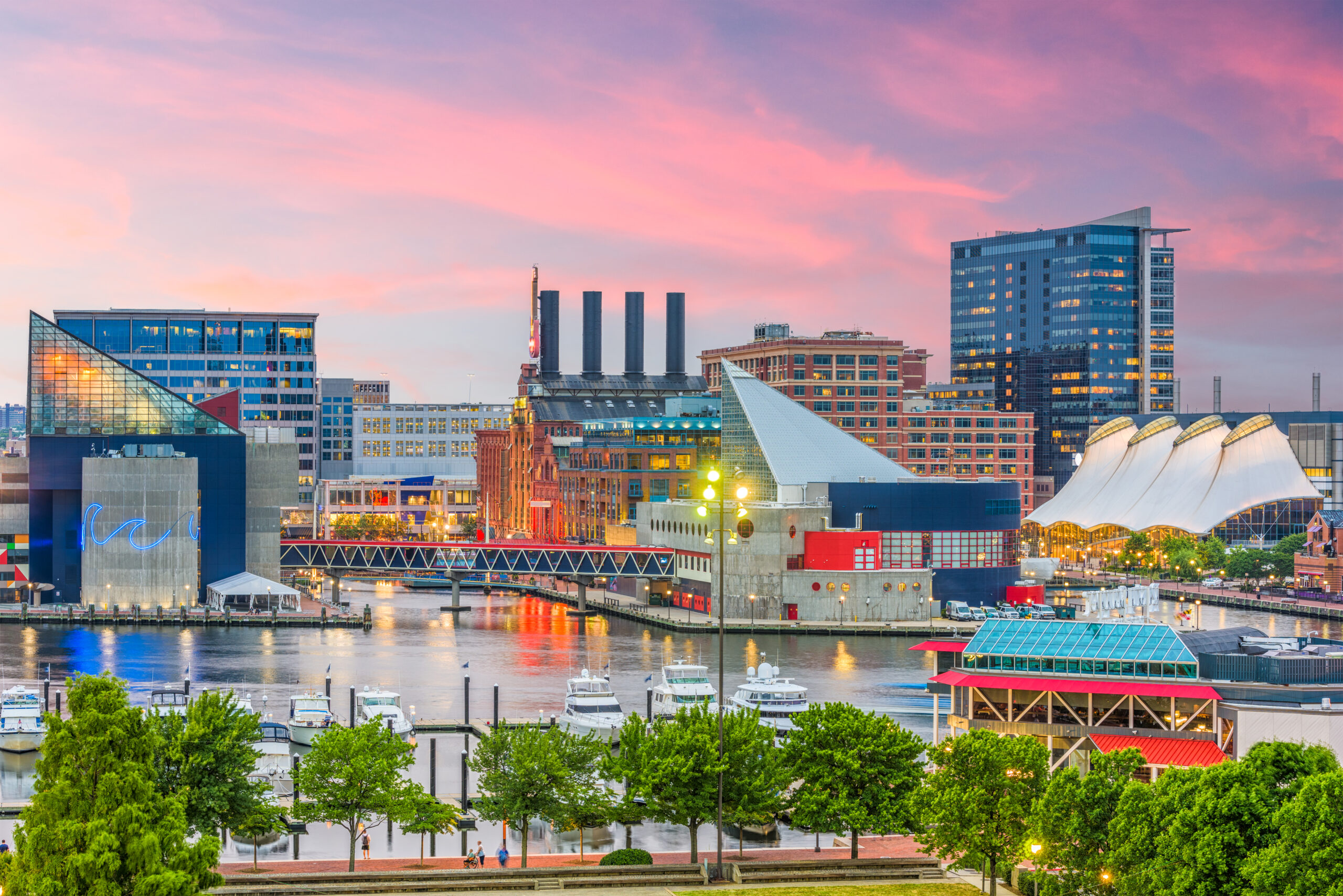 Baltimore, Maryland, USA Skyline over the Inner Harbor at dusk.