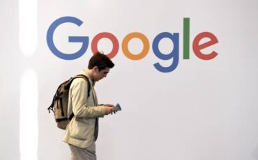 A man walks past the logo of the US multinational technology company Google during the VivaTech trade fair ( Viva Technology), on May 24, 2018 in Paris. (Photo by ALAIN JOCARD / AFP)        (Photo credit should read ALAIN JOCARD/AFP via Getty Images)