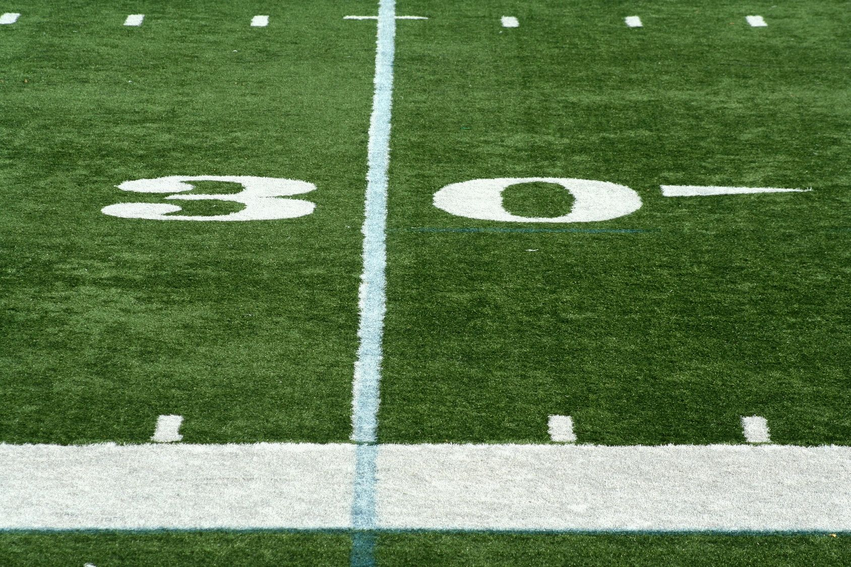 picture of the 30 yard line on a football field