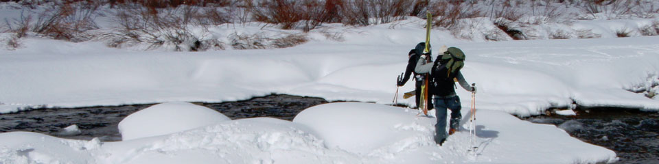 winter-trekking-across-stream.jpg