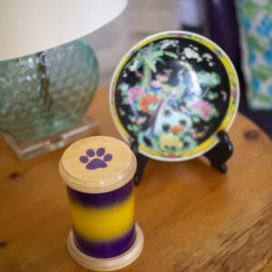 Solid Oak Pet Urn with Purple/Yellow Fade and Resin Paw Print