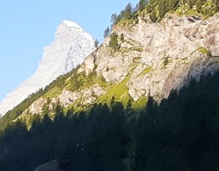 Kirley in Switzerland getting planning a hike up a mountain jpg