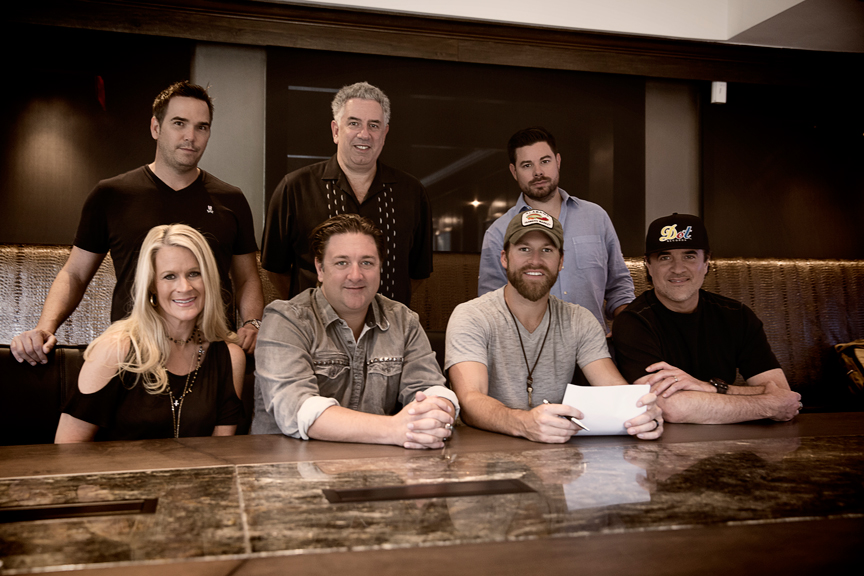Pictured (L-R): Back Row – Vector Management's Ross Schilling, Ken Levitan, Trey Wilson; Front Row – BMLG SVP A&R Allison Jones, Dot Records GM Chris Stacey, Dot Records artist Drake White, BMLG President & CEO Scott Borchetta