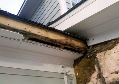 Wood rot damage caused by a small hole in a roof shingle