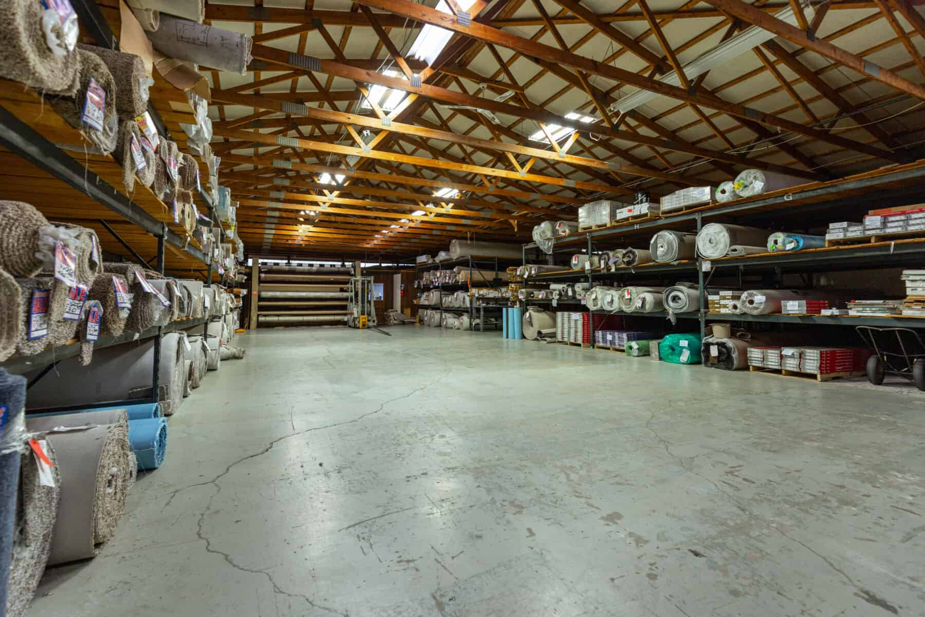 Warehouse of carpet rolls