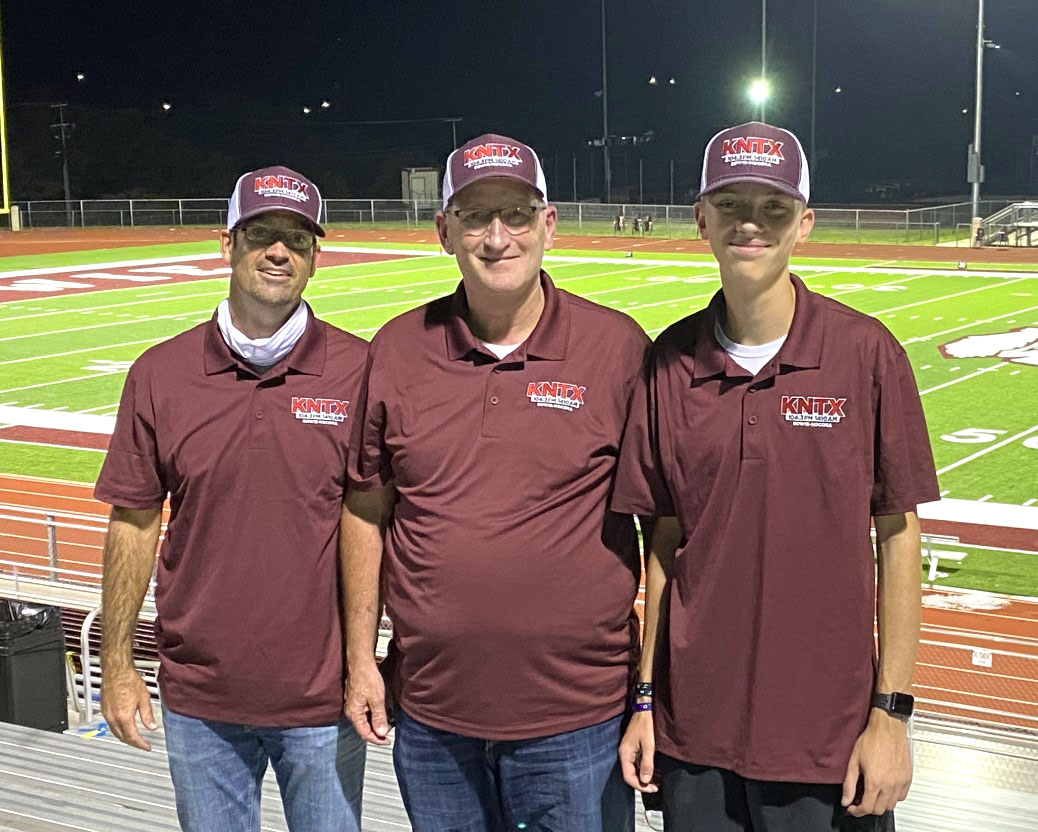 the KNTX sports team: three guys at the football field