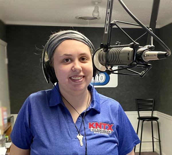 Jessica Reeves Board Op at KNTX radio on the microphone