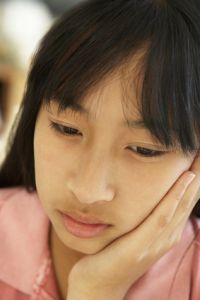 Portrait Of Unhappy Pre-Teen Girl