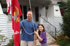 Father and daughter beside flagpole, Elizabethtown, PA