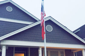 Flag and flagpole at the home of SSGT Noel