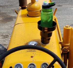 Large drinks are often wanted on a tractor and the magnetic cup holder carries them with ease.