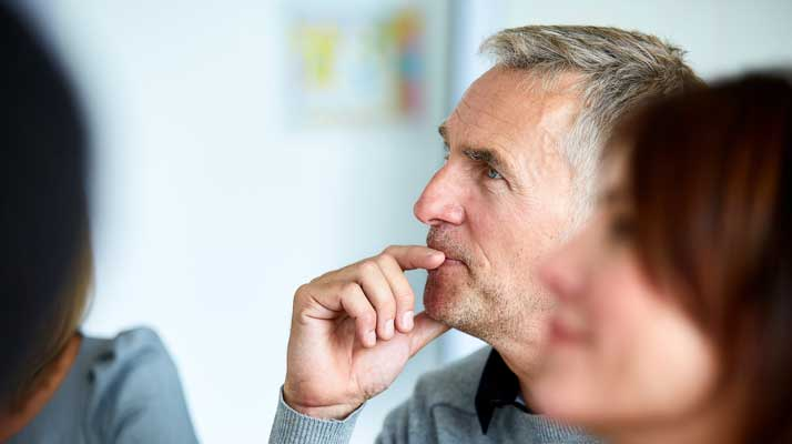 Man thinking with his finger on his lip understanding about mental health
