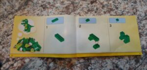 step by step instructions on how to make a green lego dinosaur