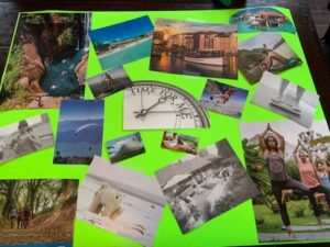cut up pictures organized across a green poster to begin vision board