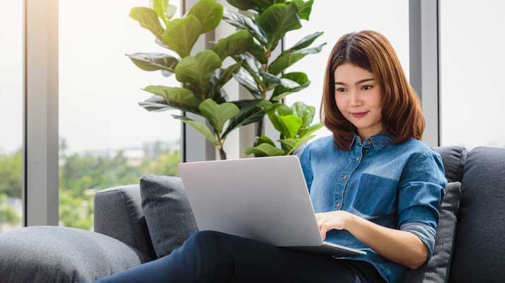 young woman researching understanding mental heath on her computer
