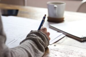 closeup of writing in a journal to practice mindfulness