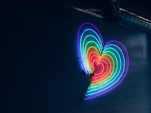 a colourful vibrant lit up heart sign