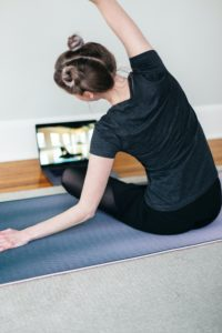 young woman on a yoga mat practicing yoga