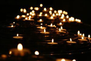 closeup of candles lit in darkness