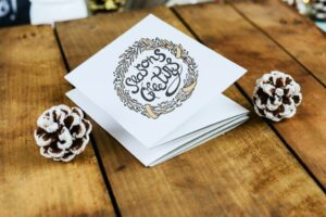 season greetings holiday cards on a wooden table