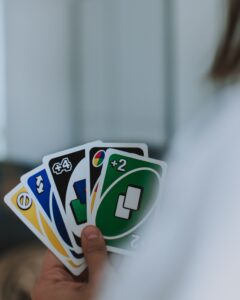 closeup of uno cards held in hand