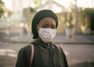 young black hijabi woman wearing a mask for mental heath feeling during pandemic