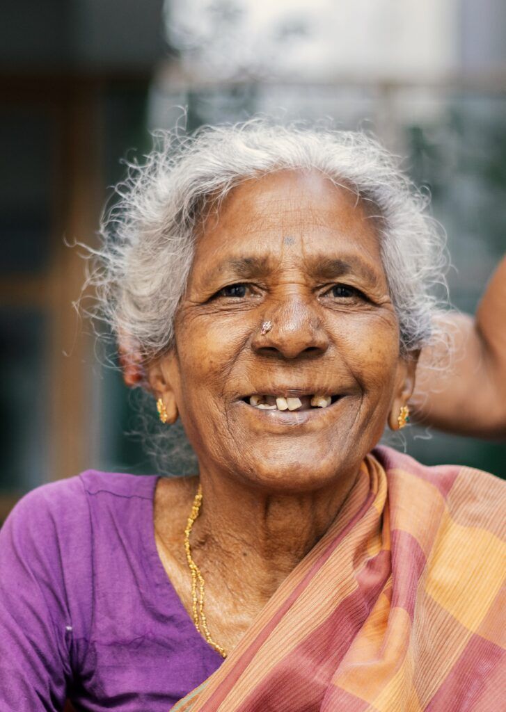 elderly brown woman smiling with healthy mental wellbeing