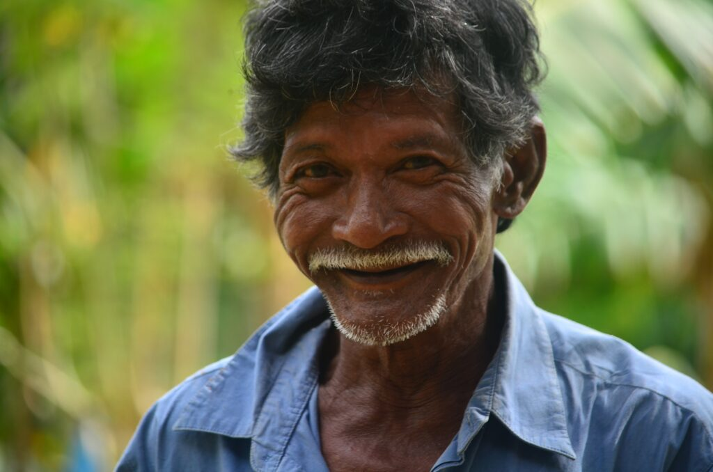 senior brown man smiling with healthy mental health