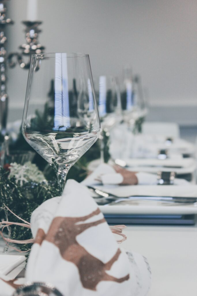 close up of empty wine glass on a set up dinner table