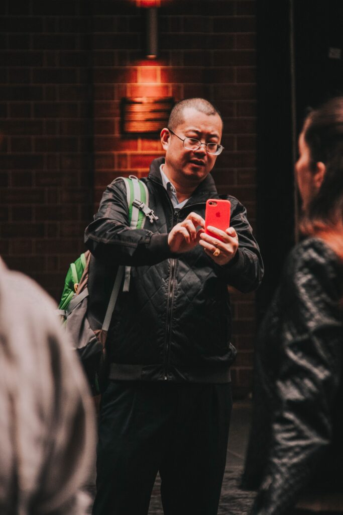 young man on his smartphone taking an image