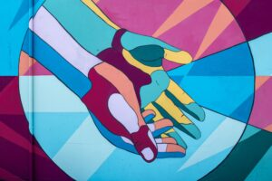 colourful art of two hands outstretched