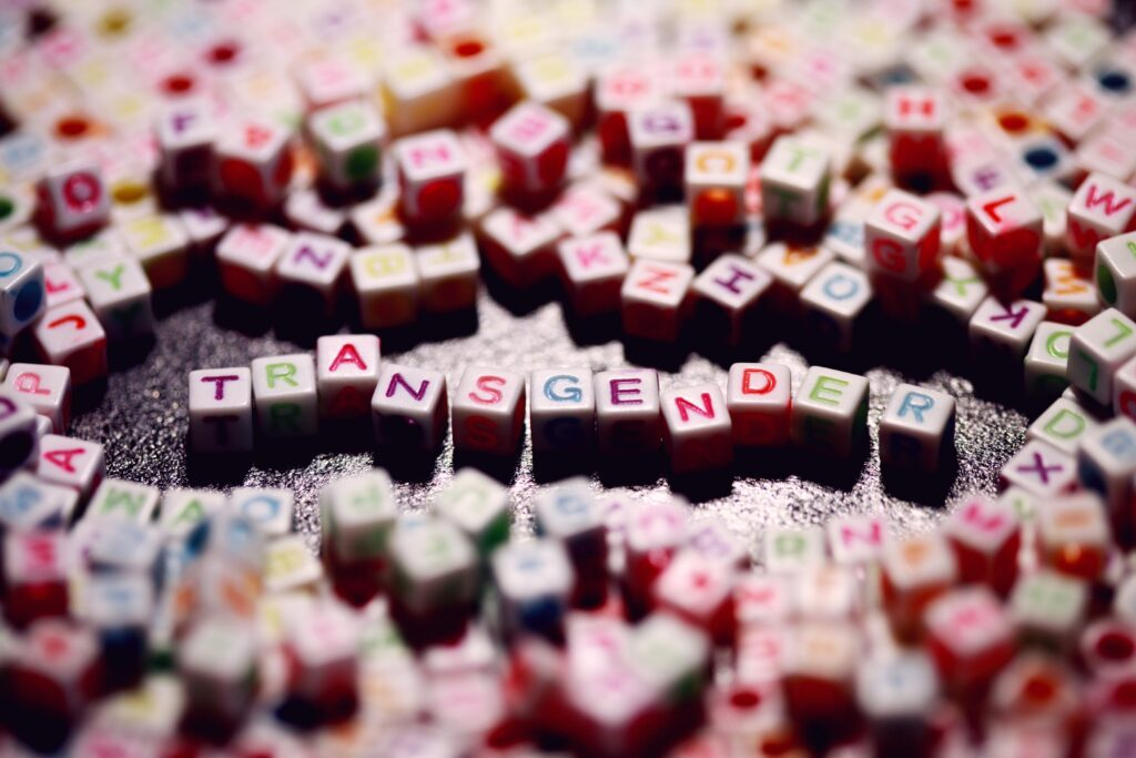 letter blocks spelling out transgender in the middle of many colour blocks