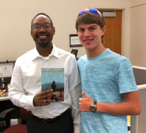 Aaron with Kal Lwanga, administrative assistant to the Town of Cicero President
