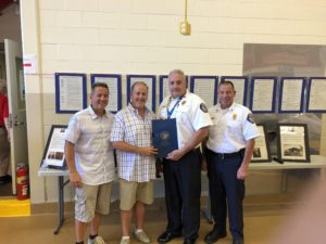Orland Fire Protection District Board President Chris Evoy, Cook County Commissioner Sean Morrison, Fire Chief Michael Schofield, and Battalion Chief Nick Cinquepalmi.