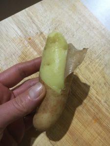 Peeling Kipfler Potato