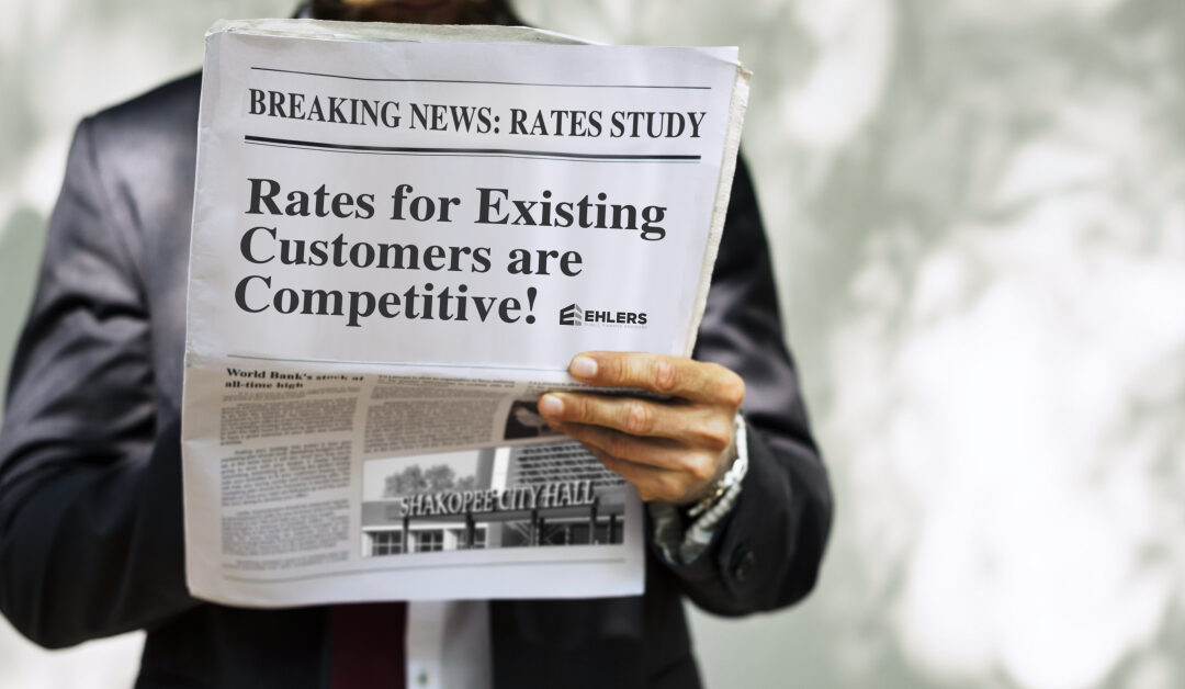 Man holding a newspaper with the headline: Breaking News: Rates Study