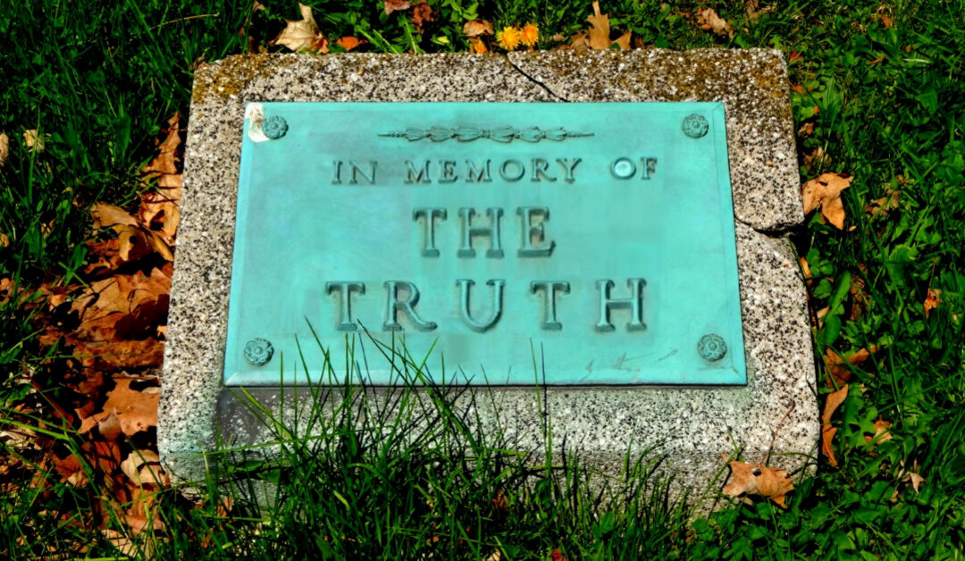 """Headstone inscribed with """"In memory of the truth."""""""