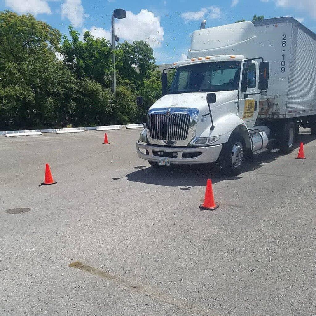 semi truck in cones course