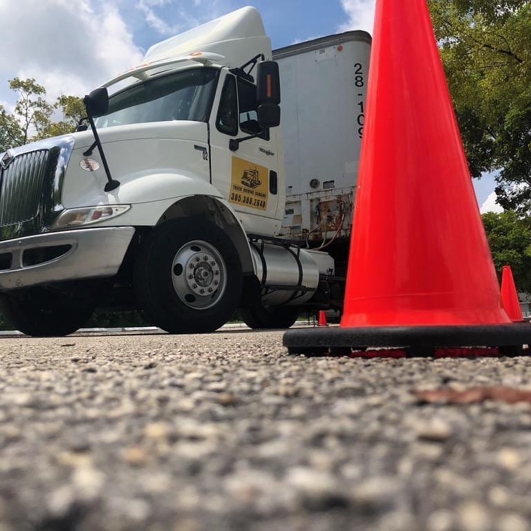 semi truck with traffic cone