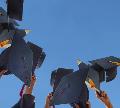 graduates throwing the hat
