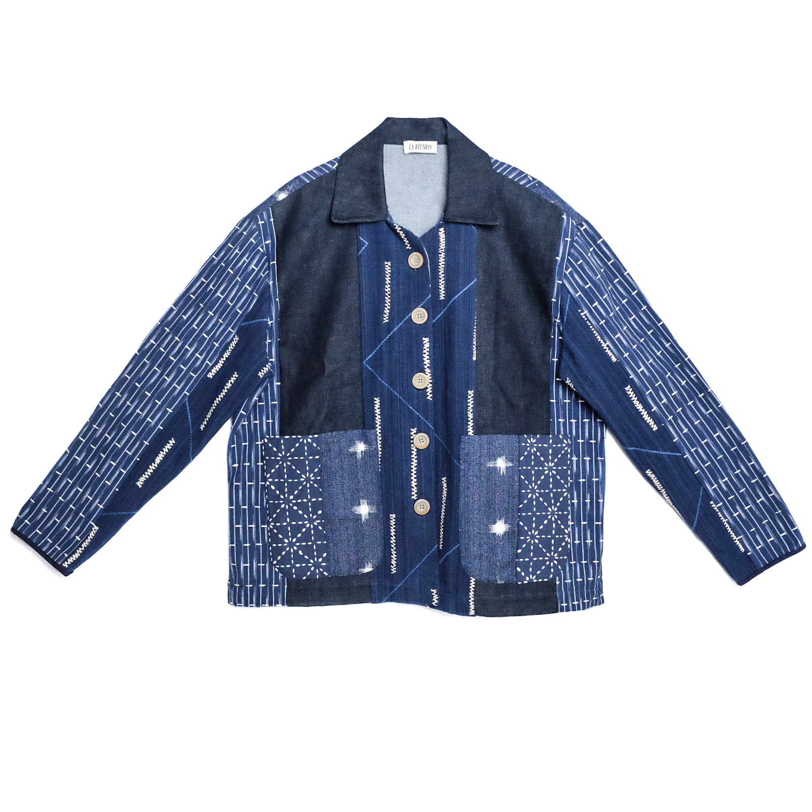 an image of an all blue patchworked jacket