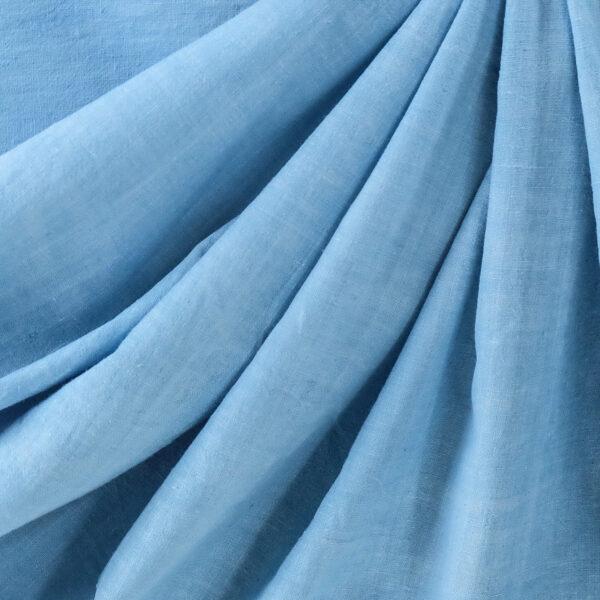 Image of sky blue organic handspun cotton fabric draped