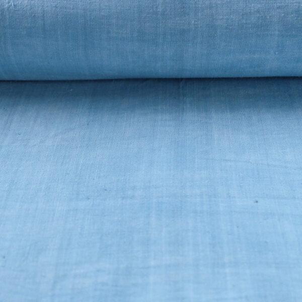 flat roll image of sky blue 11.11 handspun organic cotton fabric