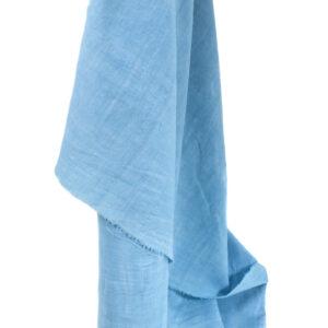 an image of sky blue handspun organic cotton fabric hanging