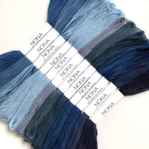 blue cotton thread in a bundle on a white background